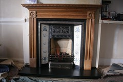 cabinetry(0.0), wood(1.0), wood-burning stove(1.0), fireplace(1.0), hearth(1.0),