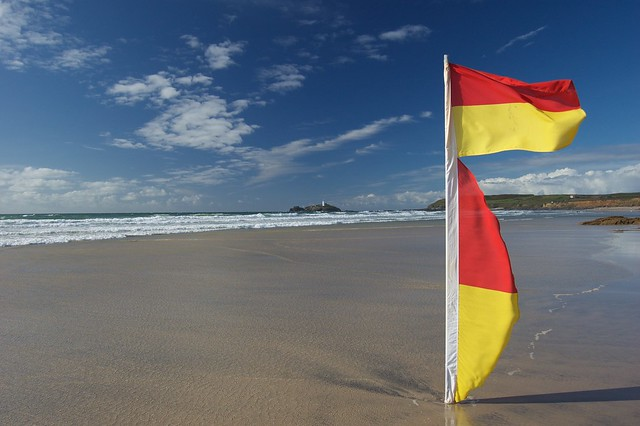 swim between the red & yellow flags