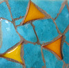 Orange triangles on turquoise - ceramic plaque on a grave
