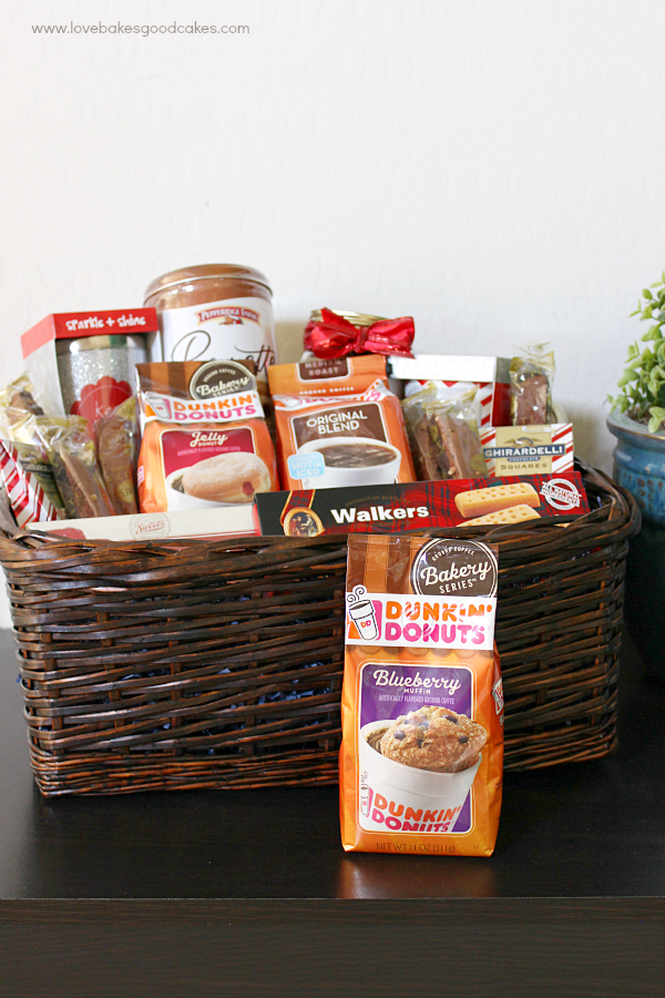 This is the perfect gift idea for all of the coffee lover's on your gift list! With Dunkin' Donuts coffee and an assortment of coffee cups and/or treats, it's an easy gift idea all year long! #DunkinToTheRescue #ad