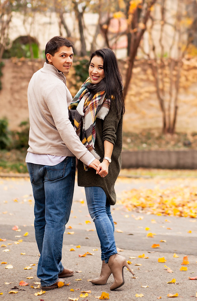 cute & little blog | petite fashion | express olive green marled tunic sweater, ag distressed jeans, plaid blanket scarf | couple picture | fall winter outfit