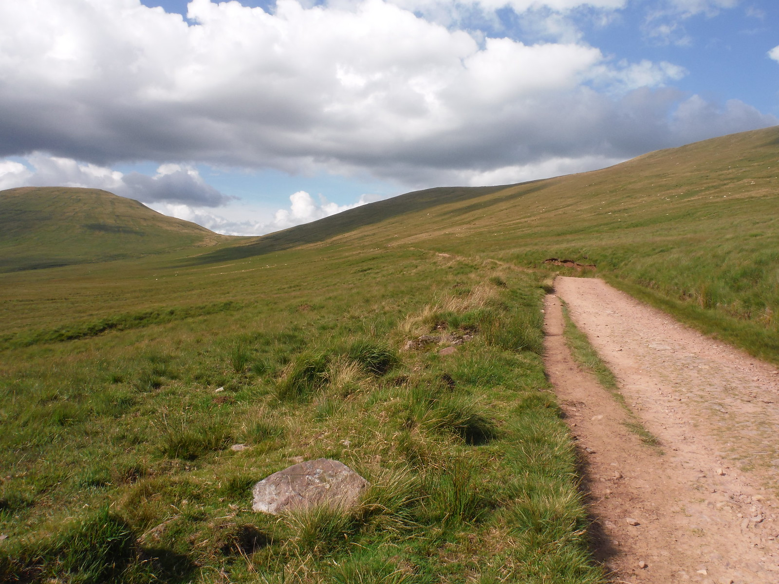 View back along the 'Old Roman Road' to the saddle between Fan y Big and Cribyn SWC Walk 278 Breacon Beacons Horseshoe - Bannau Brycheiniog