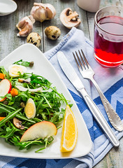 light green salad with arugula, mushrooms, quail e…
