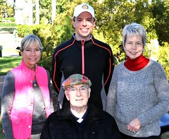 L-R: Jack Andrews' daughter Jackie Gooch, North Raleigh Rotary's President Chris Morden, Jack's daughter Janet Johnson. Seated is NRRC's treasurer Ed Cody.