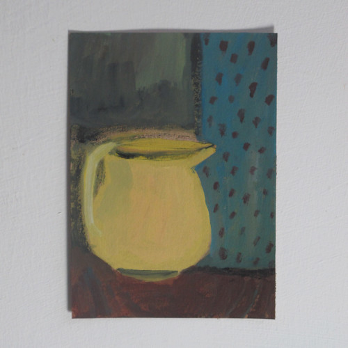 yellow jug with dotty curtain