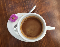 Cup of coffee with flower