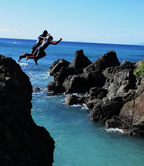 father and son cliff jumping