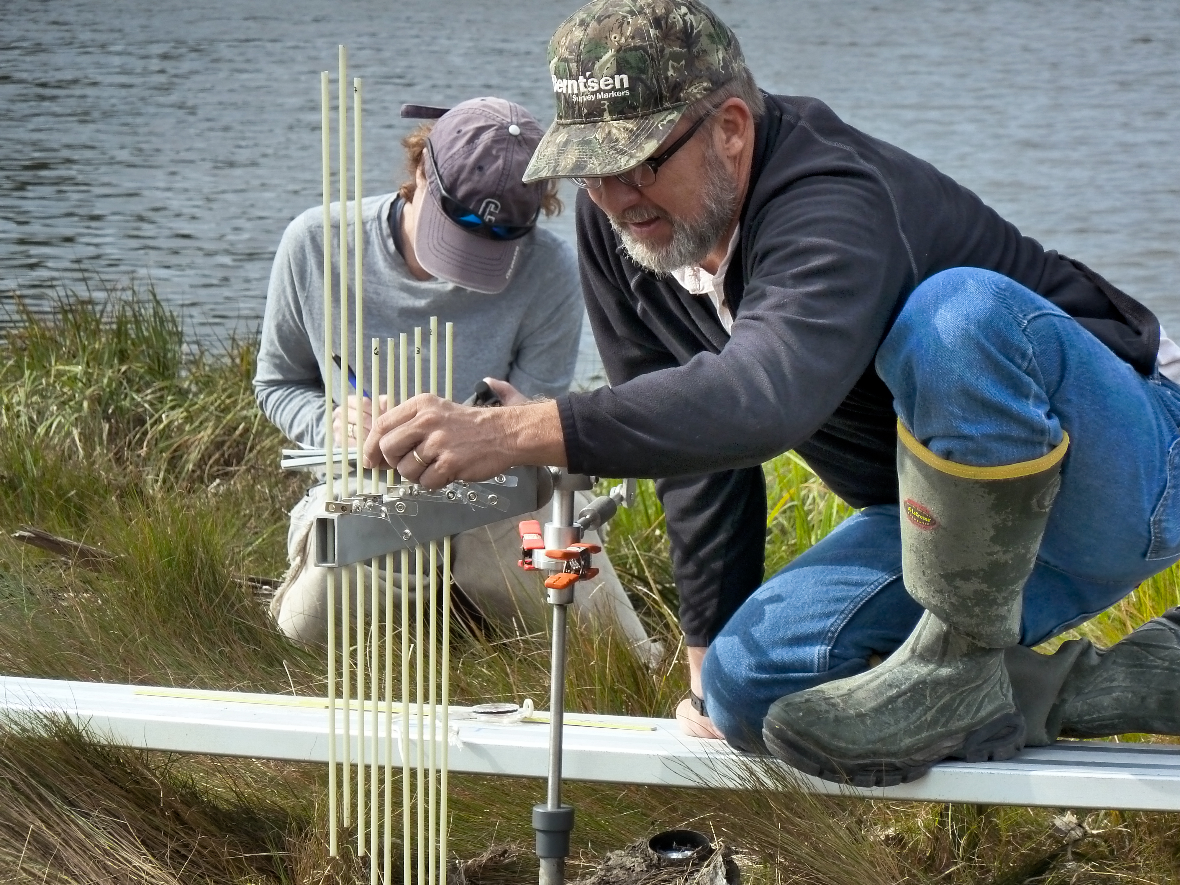 National Park Service (NPS) coastal biologist Jim Lynch uses a Surface Elevation Table (SET) to monitor the health of salt marshes. As part of an NPS monitoring program, he measures gradual elevation changes occurring on the surface of salt marshes. NPS photo.