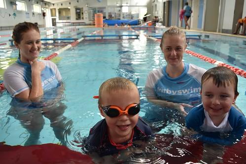 Mason Head and Isaac Ker-David with their Kirby Swim instructors.
