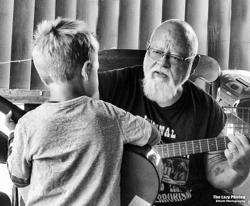 Sept 25 2016 - Titus and grandpa playing guitar on the deck