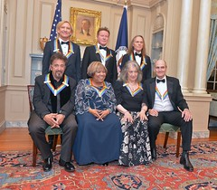 The 2016 Kennedy Center Honorees poses for a photo at the Kennedy Center Honors Dinner, attended by U.S. Secretary of State John Kerry at the U.S. Department of State in Washington, D.C. on December 4, 2016. [State Department Photo/Public Domain]