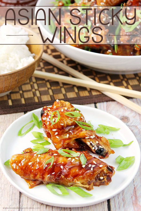 Asian Sticky Wings on a white plate with chop sticks.