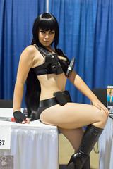 fetish model(1.0), black hair(1.0), latex clothing(1.0), clothing(1.0), limb(1.0), leg(1.0), lady(1.0), costume(1.0), thigh(1.0),