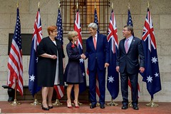U.S. Secretary of State John Kerry and U.S. Defense Secretary Ash Carter chat with their Australian counterparts - Foreign Minister Julie Bishop and Defense Minister Marise Payne - while posing for a group photo on October 13, 2015, at the Boston Public Library in Boston, Massachusetts, before their annual AUSMIN diplomatic and defense meetings. [State Department photo/ Public Domain]