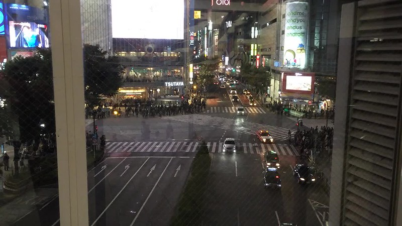 Pedestrians crossing Shibuya Crossing.