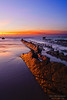 rocks in Barrika with sunset reflection by Mimadeo