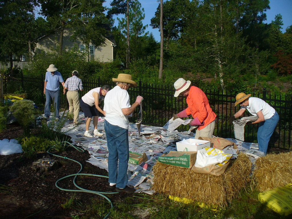 Extension Master Gardener Volunteers building a Pizza Garden at an elementary school.