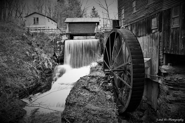 Covered bridge, waterfall and water wheel
