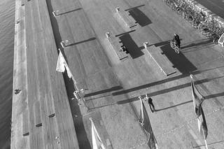 Image of  Søren Kierkegaard. densortediamant copenhagen theroyallibrary harbour denmark bicycle sørenkierkegaardsplads christiansbrygge man bicyclerider cobblestones leica aposummicronm 50mmf20asph
