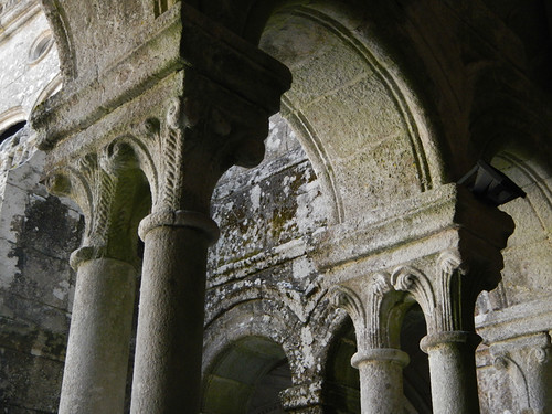 Stone columns supporting archways at the ancient monastery, now converted into a parador/hotel