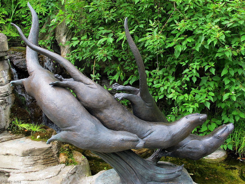 Bronze river otters sculpture
