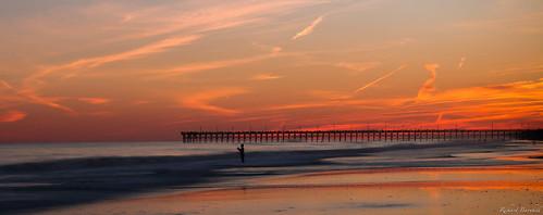 ocean travel autumn sunset vacation sky orange sun fall beach nature water clouds sand