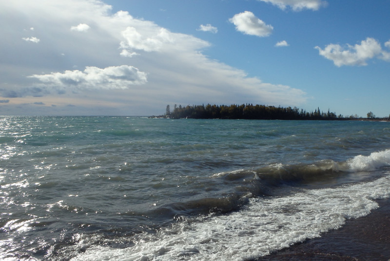 Lake Superior waves with Artists' Point in the distance
