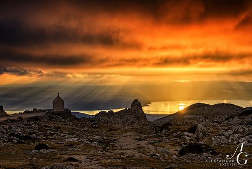 sunset red sea sun mountain reflection clouds croatia rays beams adriatic chappel velebit dinaricalps grede tulove
