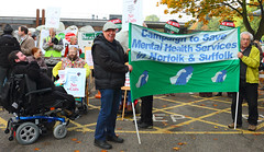 Mental health workers with banner protesting outsdie County Hall aganist Norfolk County council cuts to services