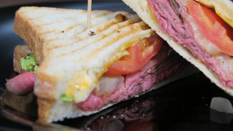 Roast Beef and Cheddar Panini with  Horseradish Mayo, Lettuce, Tomato and Onion