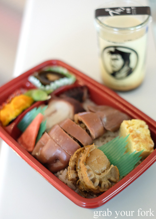 Squid and scallop bento meal and Hokkaido milk pudding at Hakodate Airport, Japan