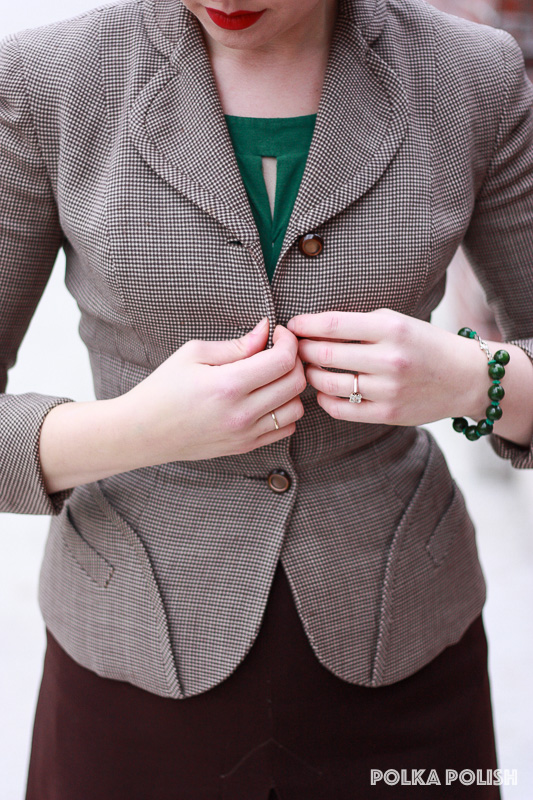 Brown checked I Magnin suit with hip detailing and trimmed collar styled with green Bakelite accessories