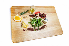 salad ingredients on a wooden board
