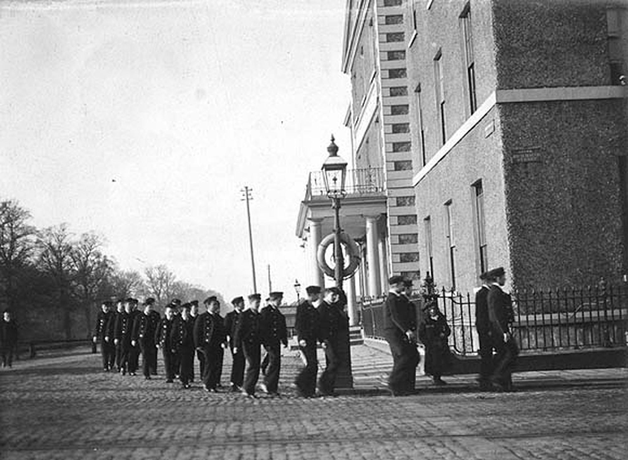 Group of boys in uniform marching at the corner of Portobello and Richmond Street South
