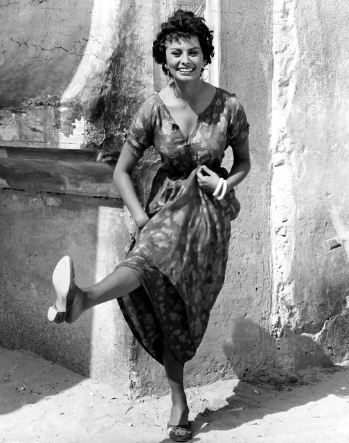 1957: Sophia Loren the Italian actress lets her hair down between scenes for the film 'Legend of the Lost', in which she co-starred with John Wayne.