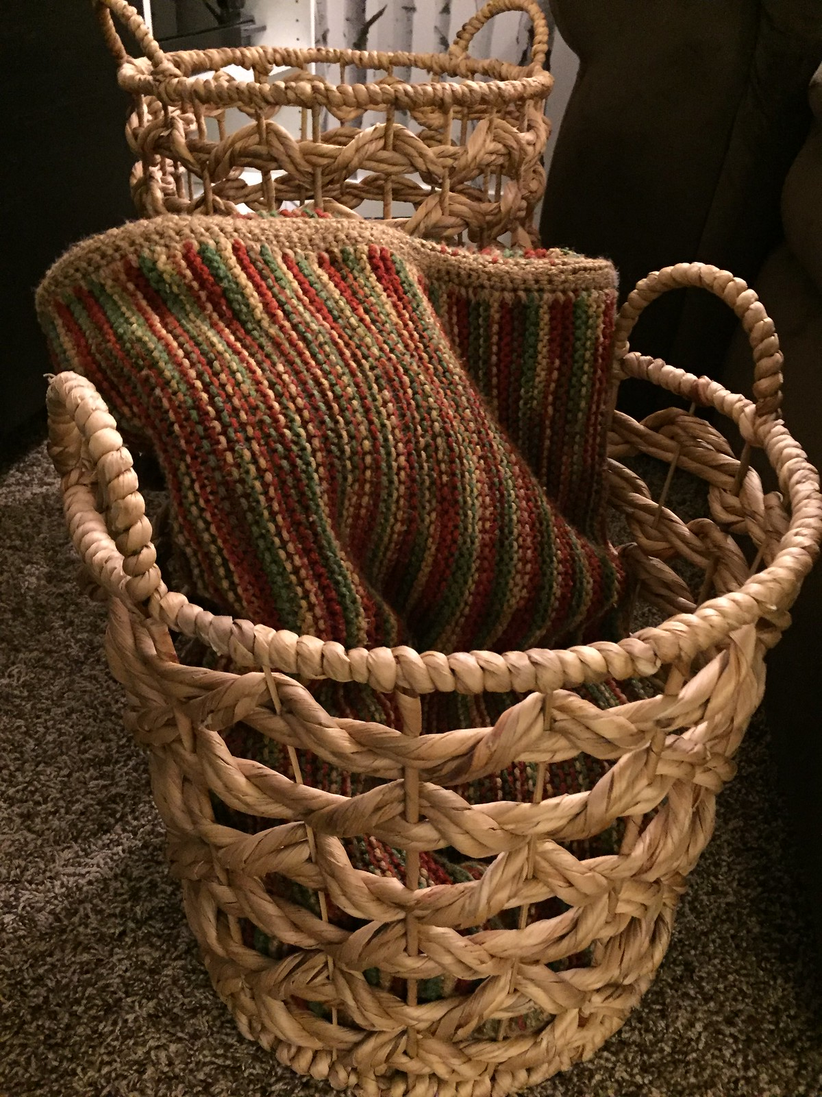 wicker basket with blankets in family room