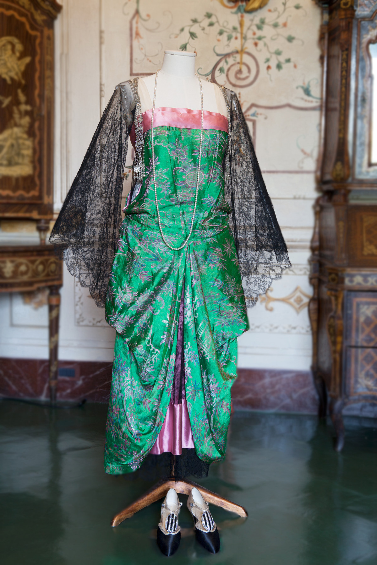 1920s. Green and Pink Silk. Passementerie tassels composed of rhinestones, pearls and beads that hang from either shoulder. Acton Art Collection - Villa La Pietra