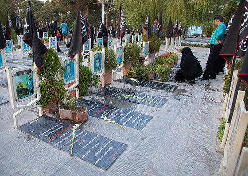 9people adults ashura cemetery colorimage commemoration dead death esfahan flag glorify grave grief groupofpeople horizontal iran iranianculture isfahan islam ispahan martyrs memorial memories memory men middleeast mourning muharram outdoors persia photography placeofburial sadness shia shiite tomb tombstone tradition tranquility tribute war women isfahanprovince ir