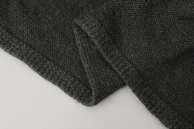 Applied 1x1 slipped rib on a commercially knit garment.