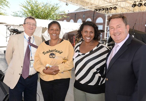 Left to right: Donald Downes vice-chairman, Eastern States CT Corporators; Marcia Johnson; Jo-Ann Hall, parent of a former Nathan Hale student; Eugene Cassidy, president and CEO, Eastern States Corp.