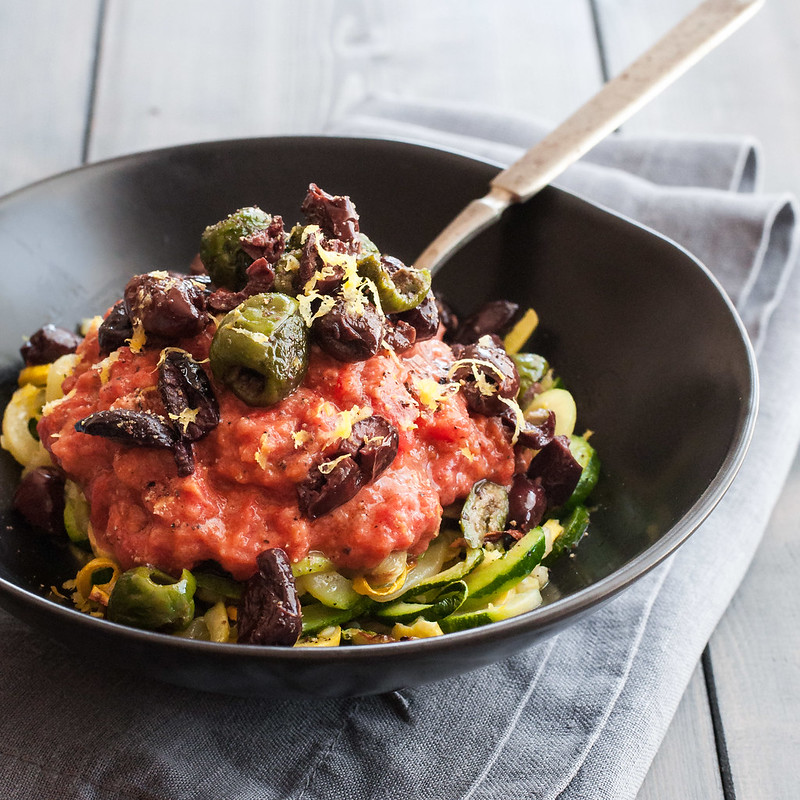 Creamy tomato sauce zucchini spaghetti with blistered olives