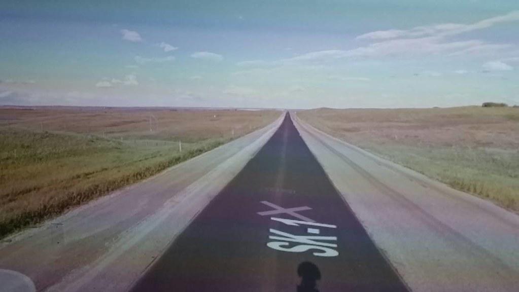 Moving along this long black line. #ridingthroughwalls #xcanadabikeride #googlestreetview #Saskatchewan