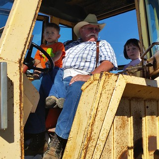 The kids got to ride with Grandpa Hugh in the tractor to move bales this weekend.