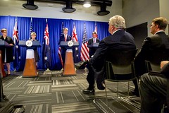 Australian Ambassador to the United States Kim Beasley and U.S. Ambassador to Australia John Berry look on as U.S. Secretary of State John Kerry addresses reporters at the Revere Hotel in Boston, Massachusetts, on October 13, 2015, during a four-way news conference with U.S. Defense Secretary Ash Carter and their Australian counterparts - Foreign Minister Julie Bishop and Defense Minister Marise Payne - following their annual AUSMIN diplomatic and defense meetings. [State Department photo/ Public Domain]