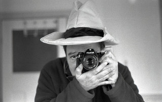 reflected self-portrait with Nikon EM camera and cowboy hat