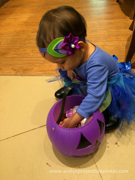 checking her Trick or Treat loots