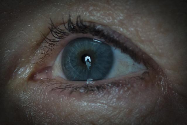 Reflection in a caver's eye - Ogof Gofan