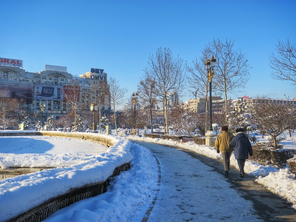 A couple walking in Bucharest, Romania