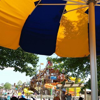 """The #twins and I are enjoying @columbuszoo #zoombezibay from the umbrella. Arianna conquered all the """"baby"""" slides like a champ and is roaring to have daddy take her to the big kid slides once the girls are done eating."""