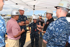 Adm. Scott Swift and Fleet Master Chief Suz Whitman listen as Project Superintendent Mike Carreira talks about shipyard innovation and personnel training during a tour of Pearl Harbor Naval Shipyard and Intermediate Maintenance Facility. (U.S. Navy photo)